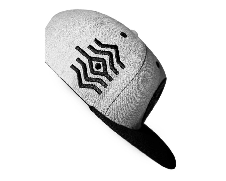 white hat with a 3rd eye design